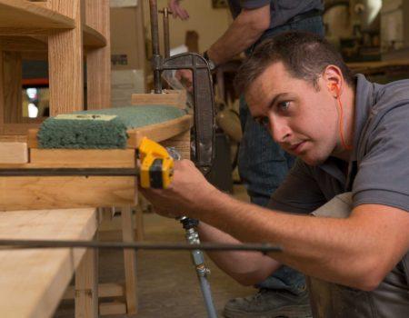 Craftsmanship pews measuring worker