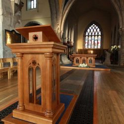 Ambo design unique bespoke engravings matching altar right side