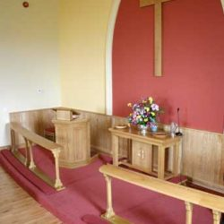 Communion Rail Church Kneelers Chairs Red Upholstery and Carpet Far Shot