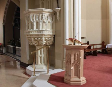 Lectern in Church at sanctuary with engravings and book stand