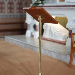 Lectern metal body gold brass colour wooden top side view