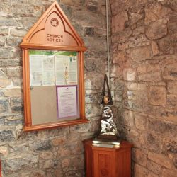 Notice board church wooden glass entrance furniture bespoke detailed engravings far shot