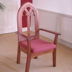 presiders chair with engravings in back arms and upholstered seat