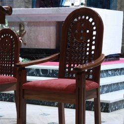Presiders chair bespoke back design and upholstered seat arms curved engraving