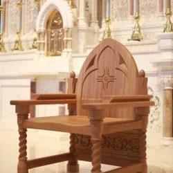 Presiders Chair detailed engravings spiral design bespoke wooden mid range shot