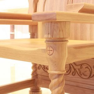 Presiders Chair detailed engravings spiral design bespoke wooden close up