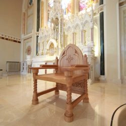 Presiders Chair detailed engravings spiral design bespoke wooden far shot