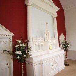 Reredos left angle white tabernacle pillars bespoke craftsmanship engraving details