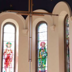 Sanctuary cross suspended on roof above sanctuary
