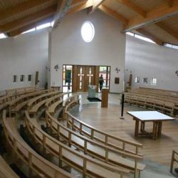Curved Pews bentwood bespoke design oval shape sanctuary in center of modern place of worship