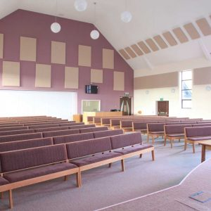 Modular seating non-stacking light purple upholstered seat and back modern worship space bespoke furniture design front view
