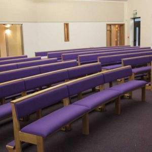 Modular seating non-stacking portrait purple upholstered seat and back kneelers contemporary worship space front view