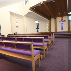 Modular seating non-stacking portrait purple upholstered seat and back kneelers contemporary worship space rear view