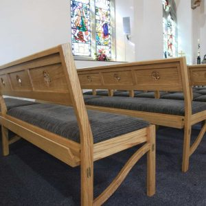 Modular seating stacking Chadderton bench side view grey upholstered seat in Church