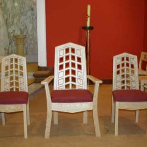 Wedding Chairs and Presiders chair with red upholstered seats and uniform back cut out design