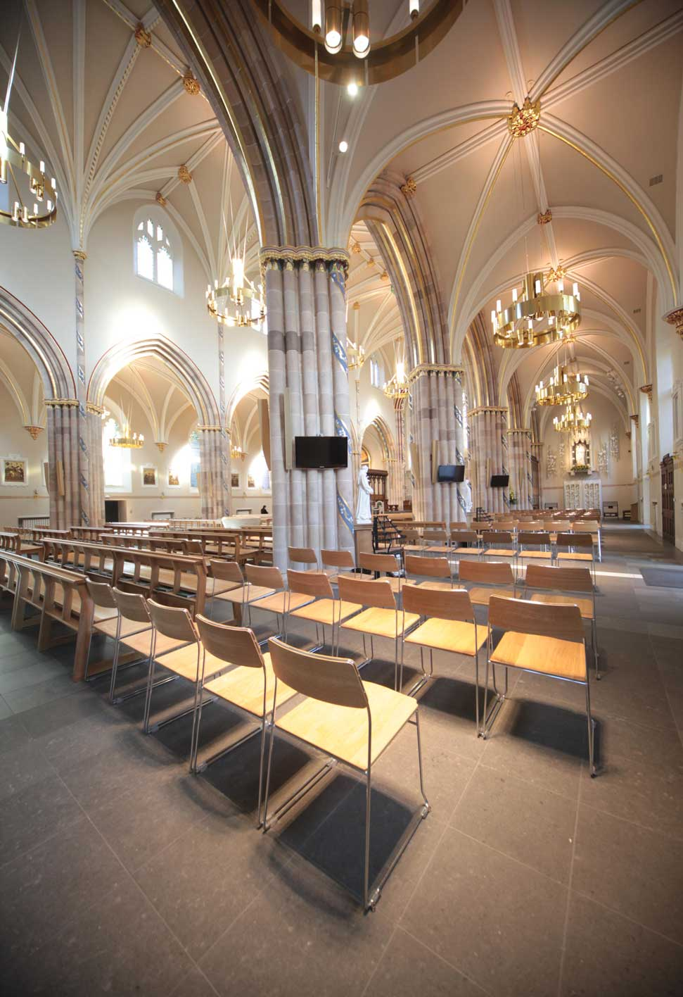 Chairs stacking metal frame all wooden bespoke design church cathedral portrait rear of church