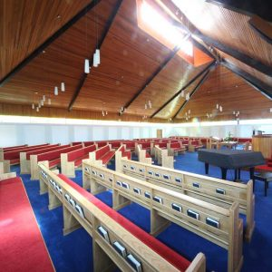 Armagh Free Presbyterian wide view of all benches pews in church bespoke book shelf red upholstered