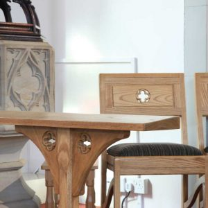 Chadderton close up of the communion rail upholstered stackable chair in background