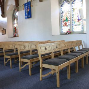 Chadderton benches stackable front of nave in church upholstered comfortable engraved