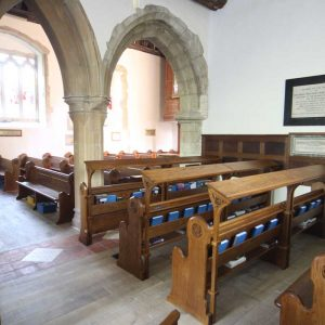 Finchemstead pews with book shelves frontal engravings