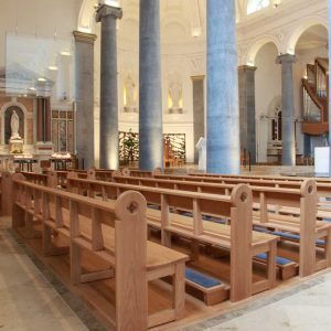 Knock Basilica St Mel's pews kneelers engravings upholstered wooden bespoke design