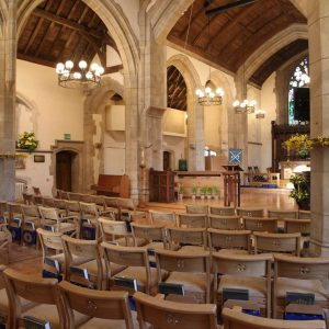 Oxshott choir stalls sound desk engravings bespoke furniture design lectern wooden chairs book shelves church nave