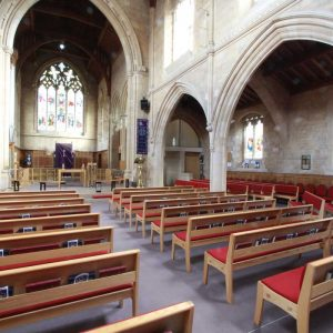 Harrogate St Mark's Church benches book shelves red upholstered bespoke rear view