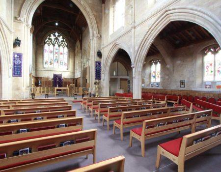 Harrogate St Mark's Church benches book shelves red upholstered bespoke rear view