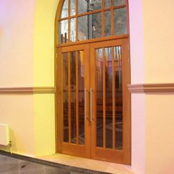 Door inside church entrance wooden cut out design with glass inlays