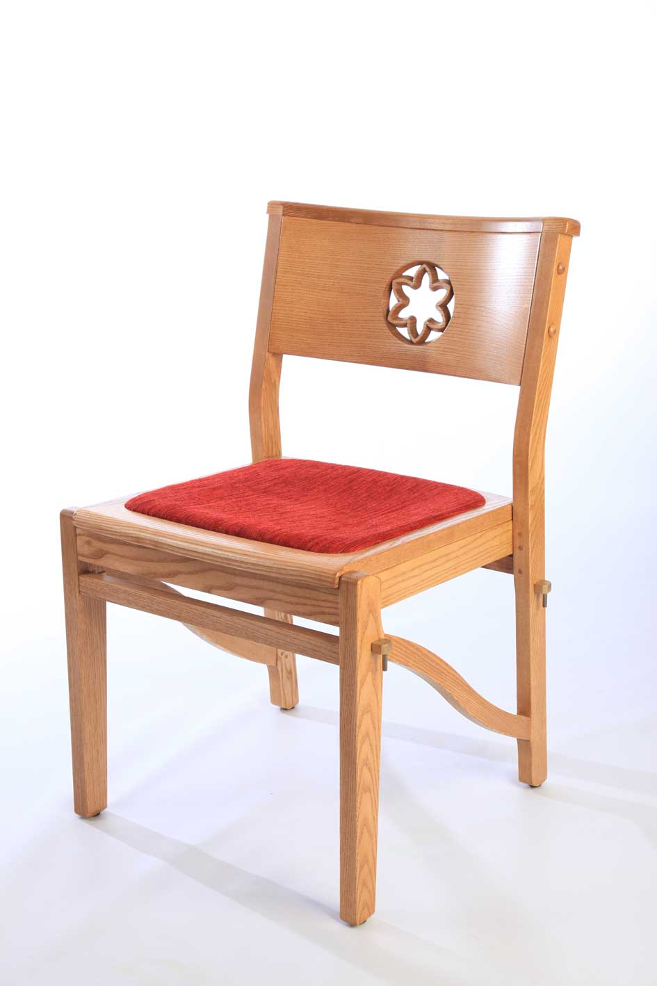 Wooden frame stackable chair with red upholstered seat and engraved back