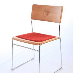 Metal frame stacking chair with bespoke back engravings and red upholstered seat