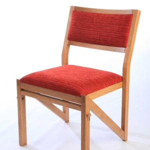 Red upholstered seat and back wooden chair stackable bespoke unique design