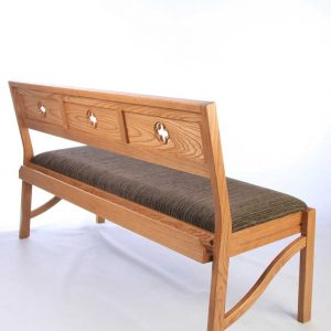 Modular seating stacking bench grey upholstered Chadderton bench with bespoke engravings and cut outs rear view book shelf