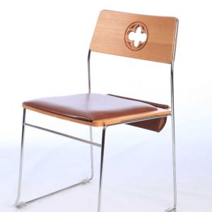 Metal frame chair with brown upholstered seat and bespoke back design and cut out