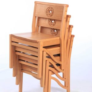 The children's chairs from Holy Trinity Church Cuckfield stacked. Bespoke engraved cut out sanded finish all wooden