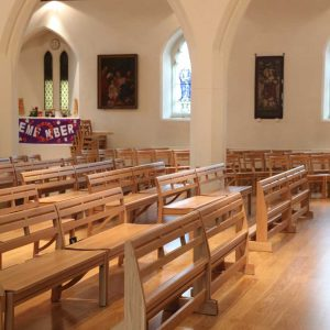 St John's Church, Farncombe stacking benches right side view with bespoke wooden kneelers
