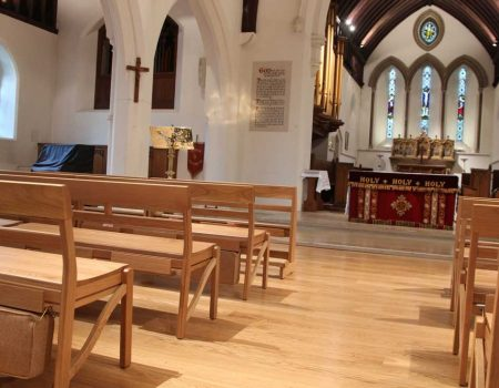 Farncombe Stacking Bench view up the central aisle of church cushion bespoke