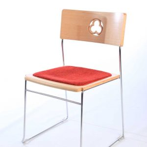 Bespoke stackable red upholstered metal frame chair with cut out