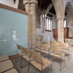 Close view of the back of metal frame stackable chairs in St. Mary's, Kirtlington