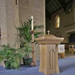 Baptismal font in church candle stand wooden engravings detailed bespoke