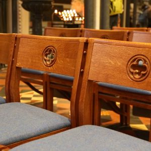 St Patrick's Cathedral close up stackable wooden frame chairs with bespoke deign and cut out